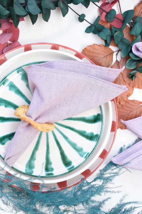 rose chambray pink linen napkin on holiday plate from atelier saucier