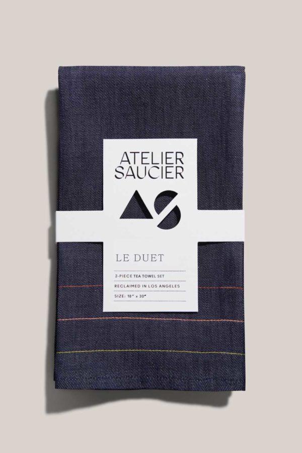 atelier saucier denim tea towel set with red orange yellow green and purple stitching