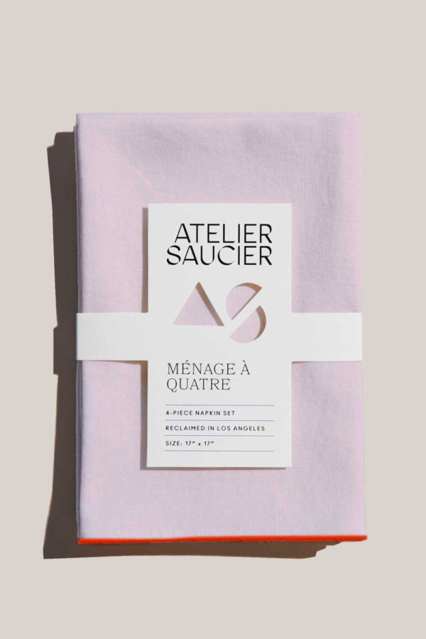 atelier saucer blush linen napkin with orange trim