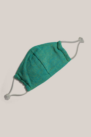 Atelier Saucier green adjustable face mask with cream straps